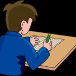 作文を書く少年
